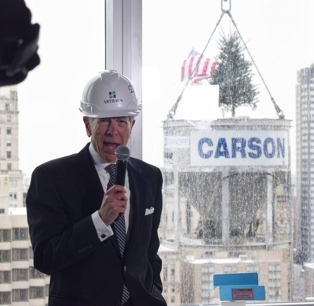Carl Dranoff speaking with the final concrete bucket in the background. Photo by Thomas Koloski
