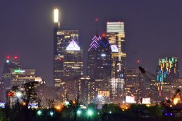 One Liberty Place and the W/Element Hotel lit up from New Jersey. Photo by Thomas Koloski