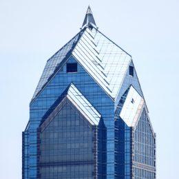 Worker on top Two Liberty Place. Photo by Thomas Koloski