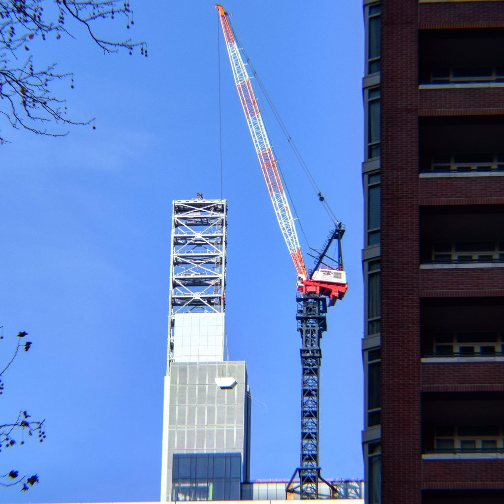 Comcast Technology Center lantern and crane from Rittenhouse Square. Photo by Thomas Koloski