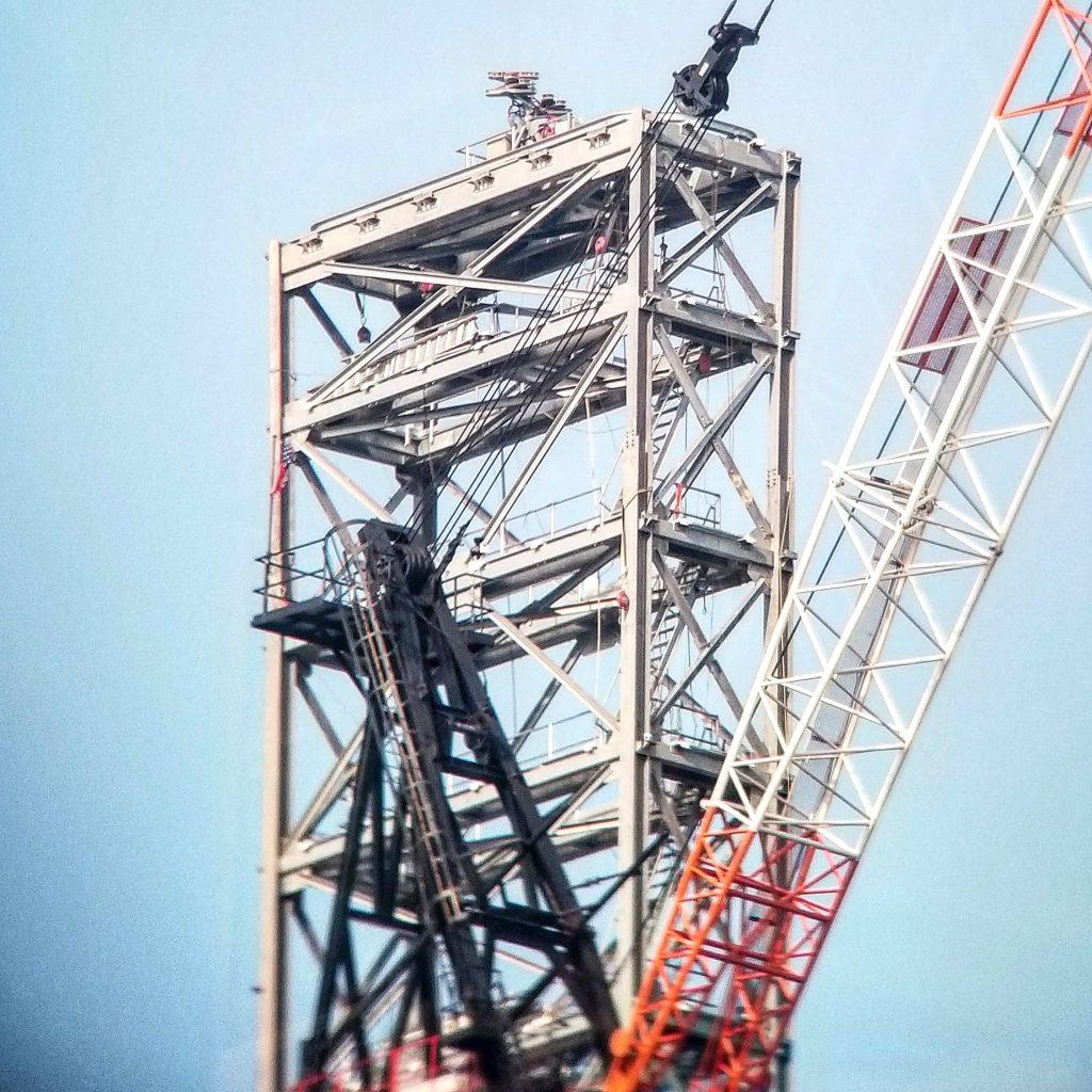 Comcast Technology Center lantern and crane close up. Photo by Thomas Koloski