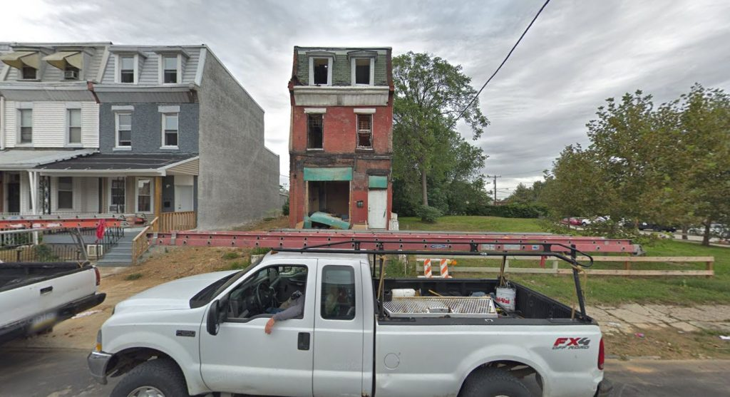 3911 Fairmount Avenue, with 3913 Fairmount Avenue. already demolished Looking north. September 2018. Credit: Google Maps